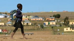 A child walks to school in June 2013 in a village outside the town of Mthatha in South Africa's Eastern Cape province. Photo: AFP/Jennifer Bruce