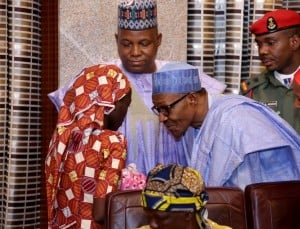 President Mohammadu Buhari speaks with the Chibok schoolgirl who was freed in May 2016. Photo: AFP