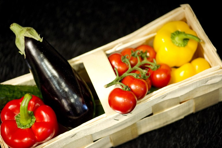 A basket containing peppers, tomatoes and aubergine. Photo: AFP/Odd Andersen