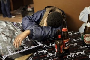 A man lies passed out on a table in a tavern in Upington in South Africa's Northern Cape province. Photo: AFP/Gianluigi Guercia