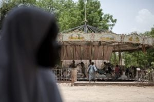 Children orphaned by Boko Haram members play on a merry-go-round in an abandoned amusement park in Maiduguri, Nigeria, in April 2017. Photo: AFP/Florian Plaucheur
