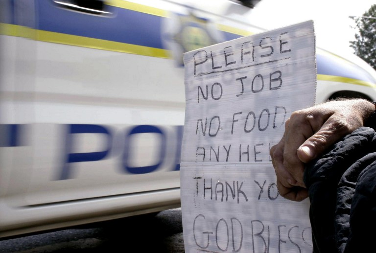 A South African beggar on a street in Johannesburg in 2005. Photo: AFP/Fati Moalusi