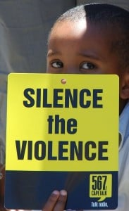 A young boy marched with 2,000 people to the South African Parliament in November 2006 to protest ongoing abuse of women and children. Photo: AFP/Rodger Bosch