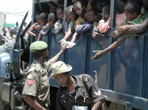 This photo taken on September 26, 2003 shows dozens of slave children being given water in the back of a police vehicle after their apprehension at the Seme border as they were being conveyed to Benin.  Photo: AFP