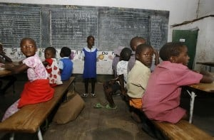 Zimbabwean children sit in a classroom at a school in Norton, 55 kms west of Harare. Photo: Desmond Kwande/AFP