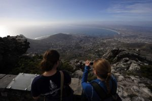Tourists take pictures of the city of Cape Town as seen from the top of Table Mountain in May 2010. Photo: AFP/GIANLUIGI GUERCIA