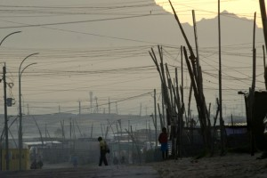 A 2010 file picture of a boy walking to school in an informal settlement in Khayelitsha, a poor area of shacks about 30 kms east of the center of Cape Town. Photo: AFP/Rodger Bosch