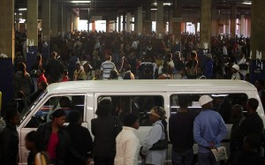 People stand in line at the Bree taxi rank in Johannesburg on June 7, 2010. Johannesburg. Photo: AFP/Paballo Thekso