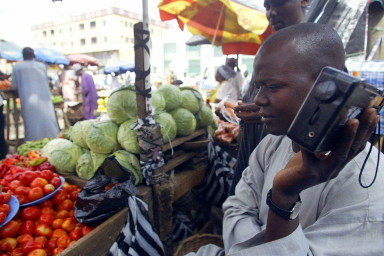 A file photograph of a stall owner in a market in Kano, Nigeria. Photo:AFP/Pius Utomi Ekpei