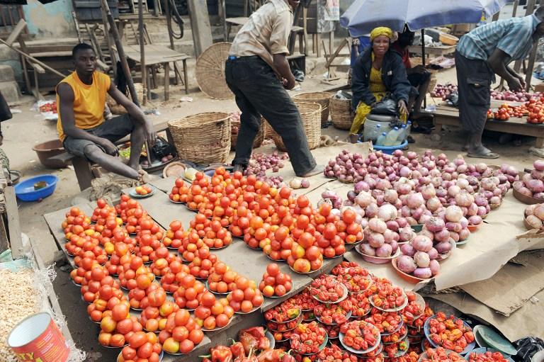 Vendors display their vegetables at Mile 12 market in Lagos. Photo: AFP/Pius Utomi Ekpei