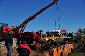 Rescue workers remove a bus that plummeted off a bridge in Meyerton, south of Johannesburg, killing nineteen people in June 2012. Photo: AFP