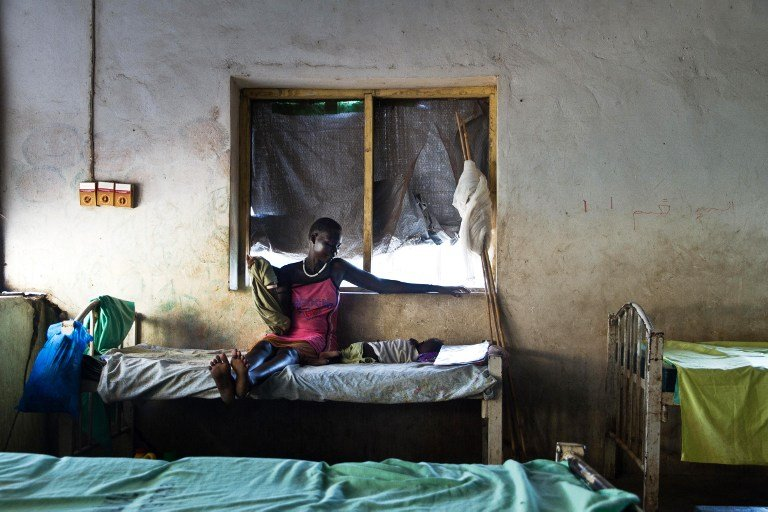 A mother watches over her baby suffering from malaria at a teaching hospital in Malakal, South Sudan, in September 2012. Photo: AFP/Camille Lepage