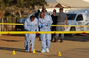 South African crime scene experts work at the scene of the shooting of a union leader who was killed inside the National Union of Mineworkers offices by two unknown gunmen, in Marikana on June 3, 2013. Photo:AFP/Stringer