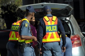 South African Police Service members search a vehicle. Photo: AFP/Alexander Joe