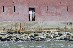 """US President Barack Obama  and First Lady Michelle Obama look out from the """"Door of No Return"""" while touring the House of Slaves, or Maison des Esclaves, at Goree Island off the coast of Dakar on June 27, 2013.  Photo: AFP/Saul Loeb"""