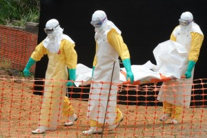 Staff from Medecin sans Frontieres prepare to bury an Ebola victim in Guekedou, Guinea on April 1, 2014. Photo: AFP/Seyllou
