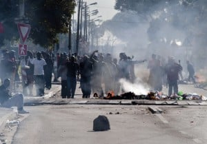 Residents from Langa in Cape Town sing and dance during a protest against housing allocations and other service delivery issues in July 2014. Police closed all routes into the township. Photo: AFP/RODGER BOSCH
