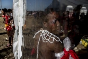 A Zulu maiden prepares for the annual reed dance ceremony inside a marquee at the eNyokeni Royal Palace in Nongoma in the KwaZulu-Natal province. Photo: AFP/MARCO LONGARI