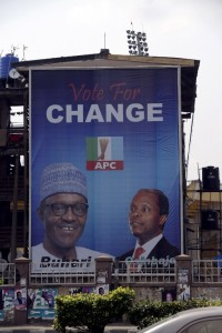 Mohammadu Buhari (left) and running mate Yemi Osinbajo pictured on an APC campaign poster. Photo: AFP/Pius Utomi Ekpei