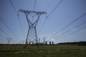 Power lines leaving the Eskom Duvha Power Station, some 15km east of Witbank, in the coal rich Witbank region of South Africa. Photo: Marco Longari/AFP