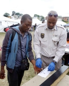 A foreign national gets his finger prints taken by a Home Affairs officials prior to returning to Zimbabwe from a temporary refugee camp. Photo: Rajesh Jantilal/AFP