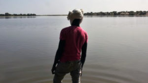 A survivor of a Boko Haram's attack looks at the waters of Lake Chad which borders Chad, Nigeria, Niger and Cameroon, in Bol on January 25, 2015. Photo: AFP/Sia Kambou