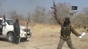 Boko Haram leader Abubakar Shekau fires an assault rifle in the air in a screen grab from the YouTube video in which he claimed responsibility for the Baga killings.