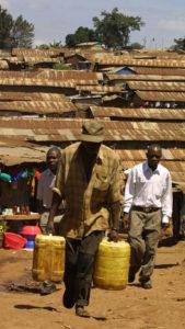 A resident of Nairobi's Kibera slum fetches water in July 2005. Photo: AFP/SIMON MAINA
