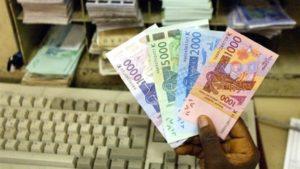 Le coût de la fabircation des signes monétaires est évoqué en gros, selon un spécialiste. Photo AFP.