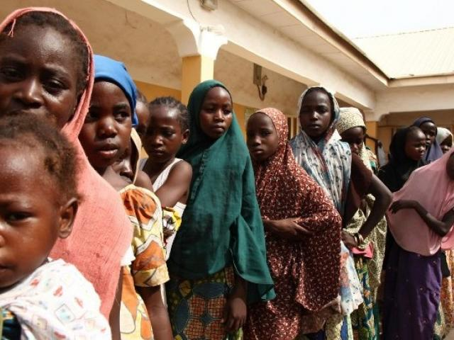 Girls rescued by Nigerian soldiers from the terrorist group Boko Haram in the Sambisa Forest line up to collect donated clothes at a refugee camp in Yola in May 2015. Photo: AFP/EMMANUEL AREWA