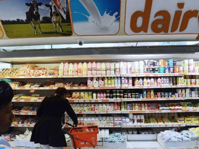 A consumer shops for dairy products in a supermarket in Kenya's capital Nairobi in July 2014. Photo: AFP/Simon Maina