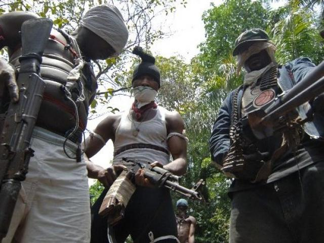 This April 2007 picture shows masked Ateke Tom militants in the Okrika region of Nigeria's Rivers State, which is situated in the restive Niger delta region. Many militant groups in the delta say they are fighting for the control of government oil we